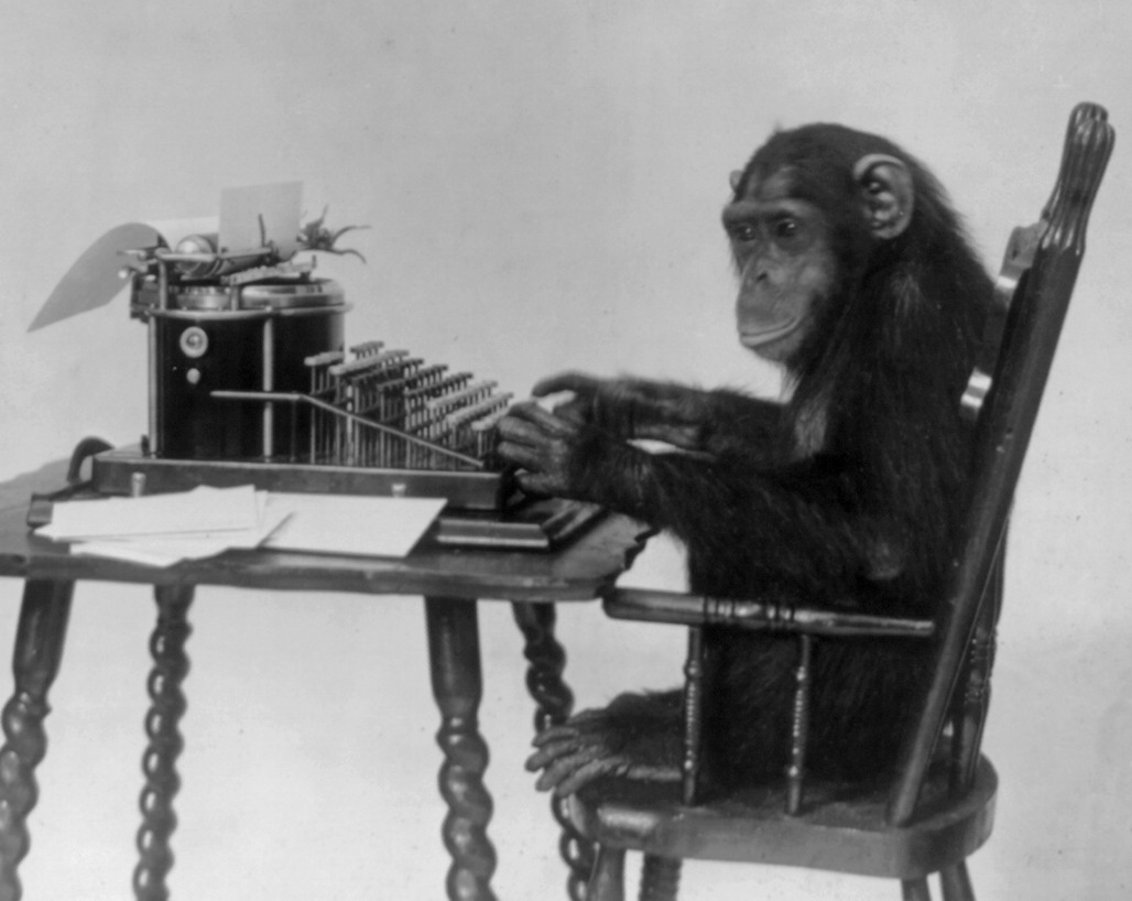 Code Monkey seated at typewriter